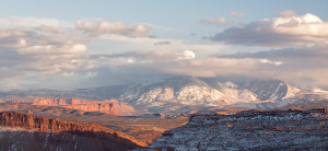 Golden light washes over the La Sal mountains near the Fiery Furnace in Arches National Park on Thursday, Feb. 21, 2013.