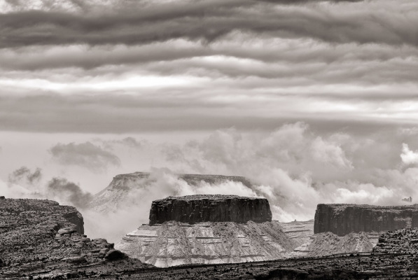 Clouds surround a mesa as seen through the South Window Arch in Arches National Park, UT, on Friday, Feb. 22, 2013.
