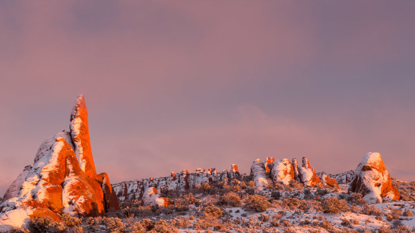 Rock fins in Arches National Park, UT, are washed in sunset light on Saturday, Feb. 23, 2013.