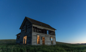 A farmhouse is washed in twilight on Tuesday, July 1, 2014 near Oakesdale, WA.