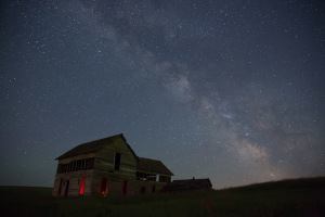 The Milky Way soars above an abandoned farmhouse near Colfax, WA, on Tuesday, July 1st, 2014.