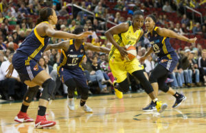 Jewell Loyd cuts through the Fever defense during a game on May 14, 2017. Loyd lead all scorers with 27 points on 10 of 18 shooting, including 3 of 4 from beyond the arc. (Neil Enns/Storm Photos)