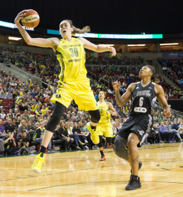 Breanna Stewart pulls in a pass from Jewell Loyd during a game against the San Antonio Stars on June 18, 2017. (Neil Enns/Storm Photos)