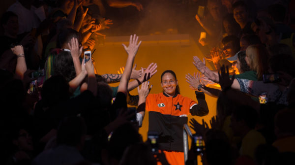 Ten-time WNBA All-Star Sue Bird, from the Seattle Storm, grins as she runs down through the crowd during player introductions at the 2017 WNBA All-Star Game on July 22, 2017. (Neil Enns/Storm Photos)